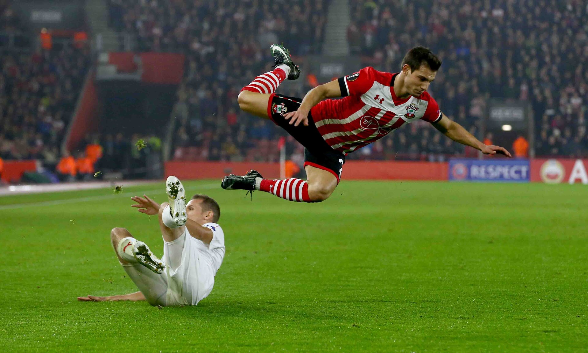 Cedric is sent flying during the UEFA Europa League match between Southampton and Hapoel Be'er Sheva F.C. at St Mary's Stadium, Southampton, England on 8 December 2016. Photo by Matt Watson/SFC/Digital South.