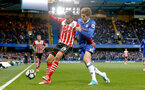 Sofiane Boufal(left) under pressure from Marcos Alonso during the Premier League match between Chelsea and Southampton at Stamford Bridge, London. Photo by Matt Watson/SFC/Digital South.