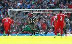 Fraser Forster saves a penalty during the Premier League match between Liverpool and Southampton at Anfield, Liverpool. Photo by Matt Watson/SFC/Digital South.