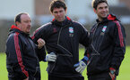 Liverpool's Spanish manager Rafael Benitez (L) speaks to coaches Xavi Valero (C) and Mauricio Pellegrino (R) during a training session at the Melwood training ground in Liverpool, northwest England, on December 8, 2009 ahead of their team's UEFA Champions League football match against Fiorentina at Anfield on December 9. AFP PHOTO/PAUL ELLIS (Photo credit should read PAUL ELLIS/AFP/Getty Images)