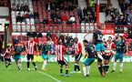 Charlie Austin heads at goal during the pre-season friendly between Brentford FC(red/white) and Southampton FC(black), at Griffin Park Stadium, Brentford, London, 22nd July 2017