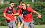 Shane Long(left) and Jan Bednarek during a Southampton FC pre season training session at the Staplewood Campus, Southampton, 31st July 2017