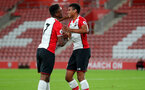 SOUTHAMPTON, ENGLAND - OCTOBER 16: Southampton's Jonathan Afolabi(left) and Marcus Barnes celebrate during the Premier League 2 match between Southampton U23 and Newcastle United U23, at St Mary's Stadium on October 16, 2017 in Southampton, England. (Photo by Matt Watson/Southampton FC via Getty Images)