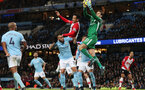 MANCHESTER, ENGLAND - NOVEMBER 29: Southampton's Maya Yoshida challenges Manchester City keeper Ederson in the air during the Premier League match between Manchester City and Southampton at the Etihad Stadium on November 29, 2017 in Manchester, England. (Photo by Matt Watson/Southampton FC via Getty Images)