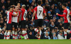 MANCHESTER, ENGLAND - NOVEMBER 29: Southampton's Oriol Romeu(centre left) celebrates with his team mates during the Premier League match between Manchester City and Southampton at the Etihad Stadium on November 29, 2017 in Manchester, England. (Photo by Matt Watson/Southampton FC via Getty Images)