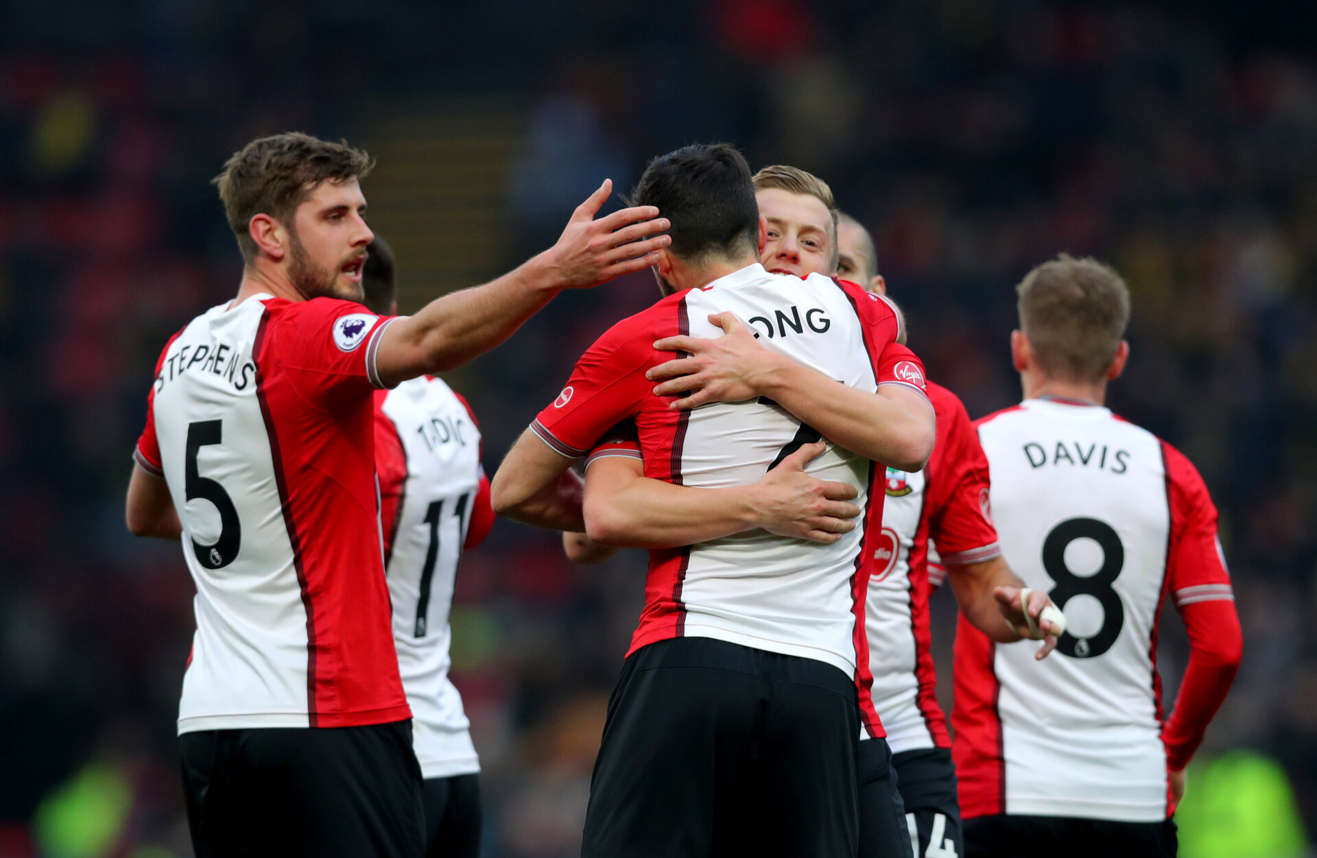 WATFORD, ENGLAND - JANUARY 13: James Ward-Prowse(R) of Southampton celebrates with Shane Long and Jack Stephens(L) during the Premier League match between Watford and Southampton at Vicarage Road on January 13, 2018 in Watford, England. (Photo by Matt Watson/Southampton FC via Getty Images)
