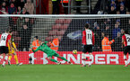 SOUTHAMPTON, ENGLAND - JANUARY 31: Alex McCarthy of Southampton FC is sent the wrong way as Glenn Murray scores from the penalty spot for Brighton during the Premier League match between Southampton and Brighton and Hove Albion at St Mary's Stadium on January 31, 2018 in Southampton, England. (Photo by Matt Watson/Southampton FC via Getty Images)
