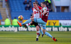 BURNLEY, ENGLAND - FEBRUARY 24: James Ward-Prowse(L) of Southampton and Stephen Ward of Burnley during the Premier League match between Burnley and Southampton at Turf Moor on February 24, 2018 in Burnley, England. (Photo by Matt Watson/Southampton FC via Getty Images)