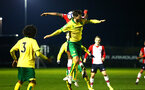 SOUTHAMPTON, ENGLAND - MARCH 12: Michael Obafemi (back) goes for the header during the PL2 match between Southampton FC and Norwich City FC at Staplewood Training Ground on March 12, 2018 in Southampton, England. (Photo by James Bridle - Southampton FC/Southampton FC via Getty Images)