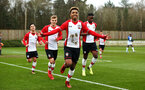 SOUTHAMPTON, ENGLAND - MARCH 17: LtoR Sean Brennan, Kornelius Hansen, Enzo Robise (goal scorer), Joanthan Afolabi during the U18's match between Southampton FC and Reading FC at Staplewood Complex on March 16, 2018 in Southampton, England. (Photo by James Bridle - Southampton FC/Southampton FC via Getty Images)