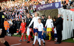 SOUTHAMPTON, ENGLAND - APRIL 06: Players make their way out with mascots ahead of the Women's World Cup Qualifier match between England and Wales match at St Mary's Stadium on April 6, 2018 in Southampton, England. (Photo by James Bridle - Southampton FC/Southampton FC via Getty Images)
