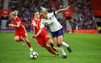 SOUTHAMPTON, ENGLAND - APRIL 06: Haley Ladd (left) of Wales takes on Englands Toni Duggan (right) during the Women's World Cup Qualifier match between England and Wales match at St Mary's Stadium on April 6, 2018 in Southampton, England. (Photo by James Bridle - Southampton FC/Southampton FC via Getty Images)