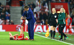 SOUTHAMPTON, ENGLAND - APRIL 06: Phil Neville (middle) rushes to help an opposition injury at the edge of the touch line during the England Lionesses vs Wales Womens match at St Mary's Stadium on April 6, 2018 in Southampton, England. (Photo by James Bridle - Southampton FC/Southampton FC via Getty Images)
