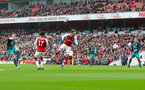 LONDON, ENGLAND - APRIL 08: Pierre-Emile Hojbjerg(L) of Southampton shoots at goal during the Premier League match between Arsenal and Southampton at Emirates Stadium on April 8, 2018 in London, England. (Photo by Matt Watson/Southampton FC via Getty Images)