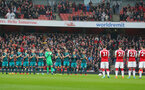 LONDON, ENGLAND - APRIL 08: players of Southampton observe an applause in memory of Ray Wilkins during the Premier League match between Arsenal and Southampton at Emirates Stadium on April 8, 2018 in London, England. (Photo by Matt Watson/Southampton FC via Getty Images)