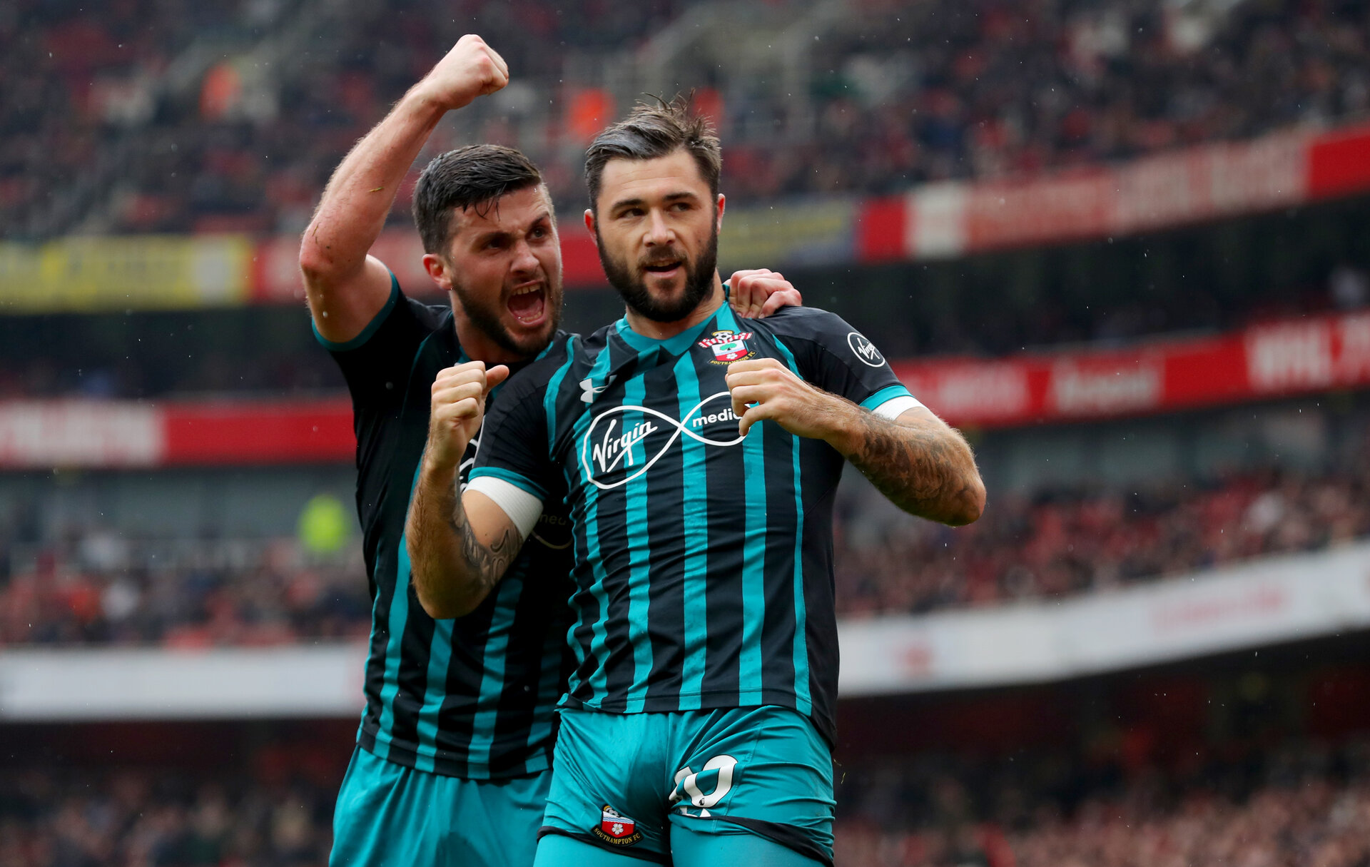 LONDON, ENGLAND - APRIL 08: Shane Long(L) and Charlie Austin of Southampton during the Premier League match between Arsenal and Southampton at Emirates Stadium on April 8, 2018 in London, England. (Photo by Matt Watson/Southampton FC via Getty Images)