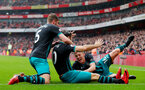 LONDON, ENGLAND - APRIL 08: Jack Stephens(L) and James Ward-Prowse(R) celebrate with Charlie Austin of Southampton after equalising during the Premier League match between Arsenal and Southampton at Emirates Stadium on April 8, 2018 in London, England. (Photo by Matt Watson/Southampton FC via Getty Images)