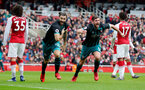 LONDON, ENGLAND - APRIL 08: Charlie Austin(L) and Jack Stephens of Southampton celebrate during the Premier League match between Arsenal and Southampton at Emirates Stadium on April 8, 2018 in London, England. (Photo by Matt Watson/Southampton FC via Getty Images)