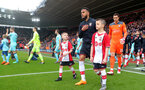 SOUTHAMPTON, ENGLAND - APRIL 28: Ryan Bertrand with the match day mascots of Southampton during the Premier League match between Southampton and AFC Bournemouth at St Mary's Stadium on April 28, 2018 in Southampton, England. (Photo by Matt Watson/Southampton FC via Getty Images)
