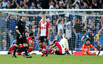 LIVERPOOL, ENGLAND - MAY 05: Oriol Romeu of Southampton with dejected team mates during the Premier League match between Everton and Southampton at Goodison Park on May 5, 2018 in Liverpool, England. (Photo by Matt Watson/Southampton FC via Getty Images)