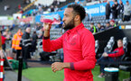 SWANSEA, WALES - MAY 08: Nathan Redmond of Southampton heads out to warm up ahead of the Premier League match between Swansea City and Southampton at Liberty Stadium on May 8, 2018 in Swansea, Wales. (Photo by Matt Watson/Southampton FC via Getty Images)
