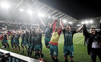 SWANSEA, WALES - MAY 08: Southampton players celebrate after winning the Premier League match between Swansea City and Southampton at Liberty Stadium on May 8, 2018 in Swansea, Wales. (Photo by Matt Watson/Southampton FC via Getty Images)