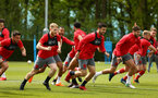 SOUTHAMPTON, ENGLAND - MAY 11: Southampton FC players, Josh Sims, Shane Long, Jack Stephens,  during a warm up exercise ahead of a training session at Staplewood Complex on May 11, 2018 in Southampton, England. (Photo by James Bridle - Southampton FC/Southampton FC via Getty Images)