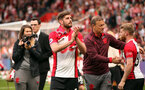 SOUTHAMPTON, ENGLAND - MAY 13: Jack Stephens and Josh Sims. Lap of appreciation after the Premier League match between Southampton and Manchester City at St Mary's Stadium on May 13, 2018 in Southampton, England. (Photo by Chris Moorhouse/Southampton FC via Getty Images)