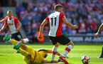 SOUTHAMPTON, ENGLAND - MAY 13: Dusan Tadic (right) of Southampton FC beats Manchester City's Claudio Bravo (left) during the Premier League match between Southampton and Manchester City at St Mary's Stadium on May 13, 2018 in Southampton, England. (Photo by James Bridle - Southampton FC/Southampton FC via Getty Images)