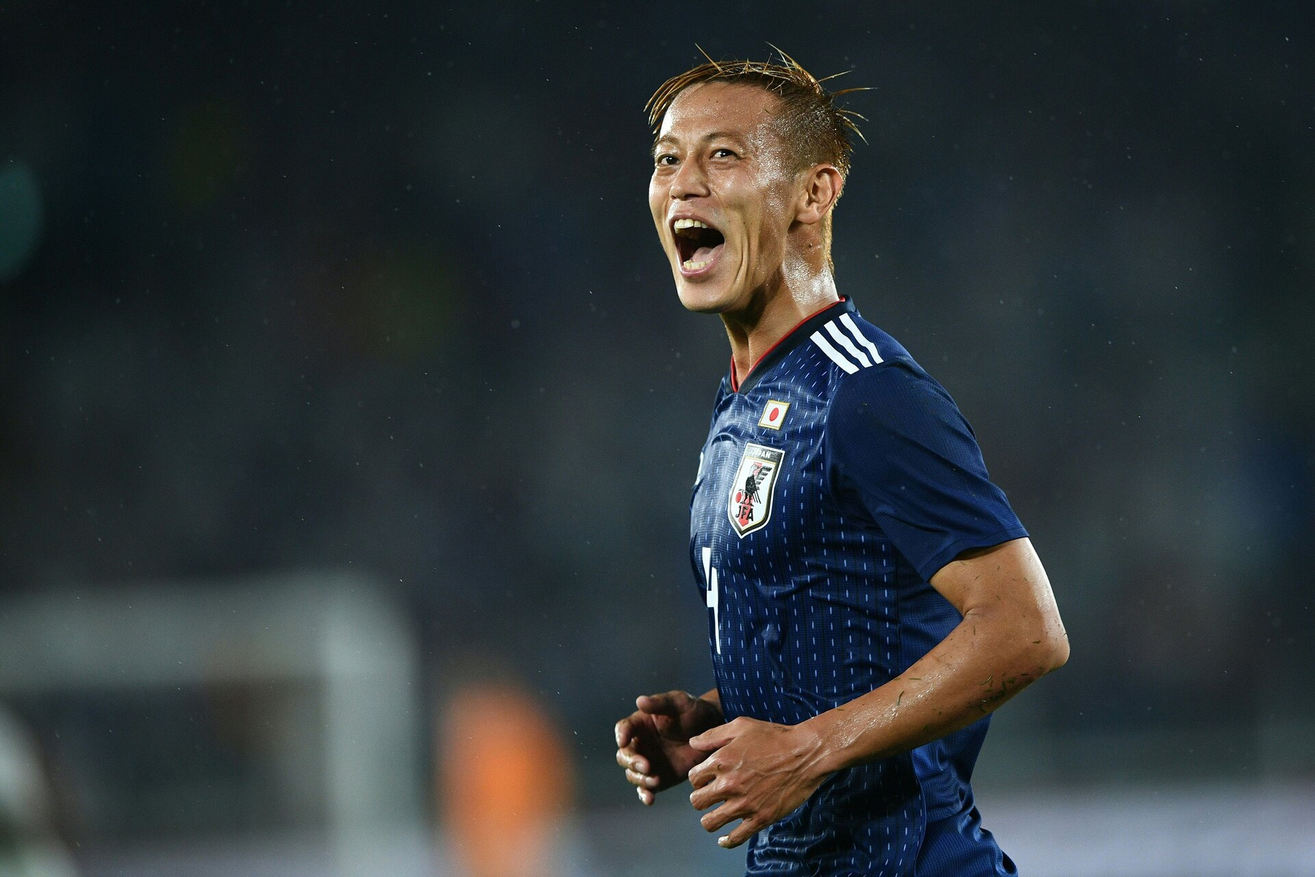 Japan's National football team midfielder Keisuke Honda reacts after missing a goal, during their international friendly football match between Japan and Ghana at the Nissan stadium in Yokohama, on May 30, 2018. (Photo by Martin BUREAU / AFP)        (Photo credit should read MARTIN BUREAU/AFP/Getty Images)