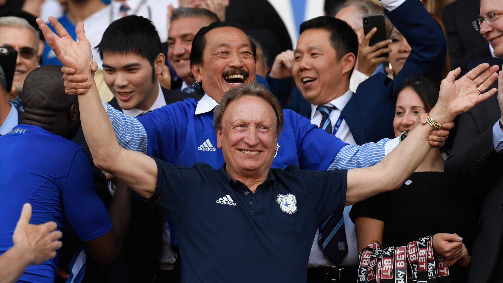 CARDIFF, WALES - MAY 06:  Cardiff owner Vincent Tan and manager Neil Warnock celebrate promotion to the premier league after the Sky Bet Championship match between Cardiff City and Reading at Cardiff City Stadium on May 6, 2018 in Cardiff, Wales.  (Photo by Stu Forster/Getty Images)