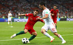 SOCHI, RUSSIA - JUNE 15:  Cedric of Portugal and Isco of Spain battle for the ball during the 2018 FIFA World Cup Russia group B match between Portugal and Spain at Fisht Stadium on June 15, 2018 in Sochi, Russia.  (Photo by Dean Mouhtaropoulos/Getty Images)