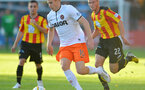 GLASGOW, SCOTLAND - AUGUST 02:  Gary Fraser of Partick Thistle and Stuart Armstrong of Dundee United in action during the Scottish Premiership League match between Partick Thistle and Dundee United at Firhill Stadium on August 02, 2013 in Glasgow, Scotland. (Photo by Mark Runnacles/Getty Images)