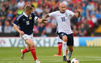 SHEFFIELD, ENGLAND - AUGUST 13:  Jonjo Shelvey of England U21 holds off a challenge from Stuart Armstrong of Scotland U21 during the Kick It Out International between England U21 and Scotland U21 at Bramall Lane on August 13, 2013 in Sheffield, England.  (Photo by Alex Livesey/Getty Images)