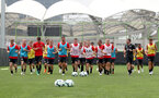 Players warm up during the first training session of Southampton FC's pre-season tour of China, at the Kunshan training facility, Kunshan, Shanghai, China, 2nd July 2018