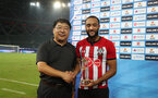 XUZHOU, CHINA - JULY 11: Nathan Redmond is presented with an award after the 2018 Club Super Cup pre-season match between Southampton FC and Jiangsu suning FC, on July 11, 2018 in Xuzhou, China. (Photo by Matt Watson/Southampton FC via Getty Images)