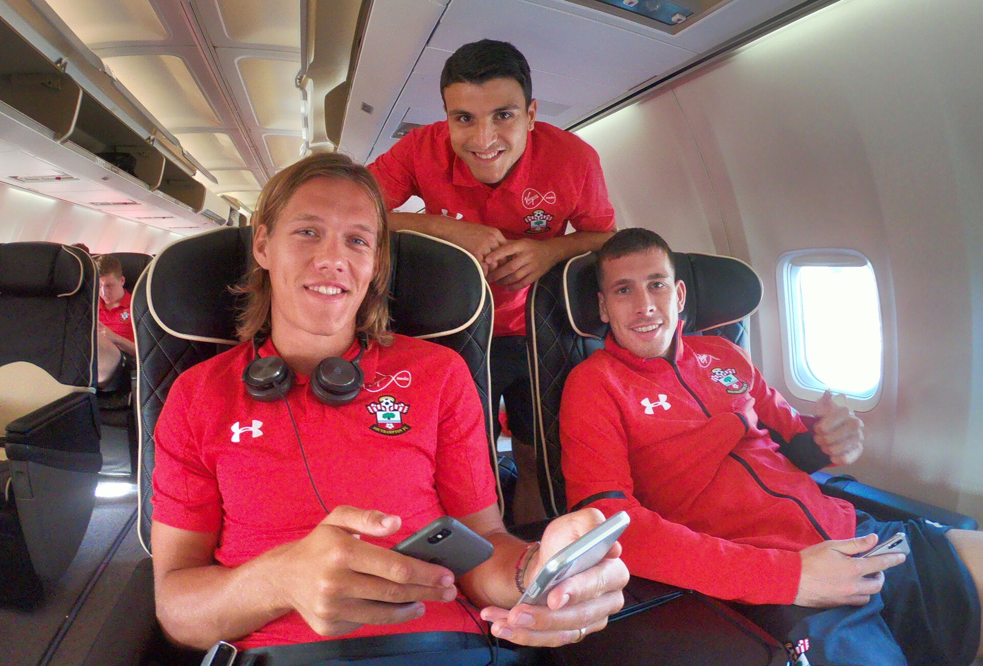 EVIAN-LES-BAINS, FRANCE - JULY 23: Players board the plane as Southampton FC take part in their first day of their pre-season training camp, Jannik Vestergaard(L), Mohamed Elyounoussi(centre) and Pierre-Emile Hojbjerg(R) on July 23, 2018 in Evian-les-Bains, France. (Photo by Matt Watson/Southampton FC via Getty Images)
