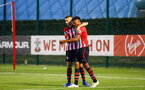SOUTHAMPTON, ENGLAND - AUGUST 10: Will Smallbone (left) congratulates Marcus Barnes (Right) on his goal during the PL2 match between Southampton FC vs Middlesbrough FC pictured at Staplewood Complex on August 10, 2018 in Southampton, England. (Photo by James Bridle - Southampton FC/Southampton FC via Getty Images)