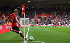 SOUTHAMPTON, ENGLAND - AUGUST 12: Stuart Armstrong (left) of Southampton FC  takes a corner during the Premier League match between Southampton FC and Burnley FC at St Mary's Stadium on August 12, 2018 in Southampton, United Kingdom. (Photo by James Bridle - Southampton FC/Southampton FC via Getty Images)