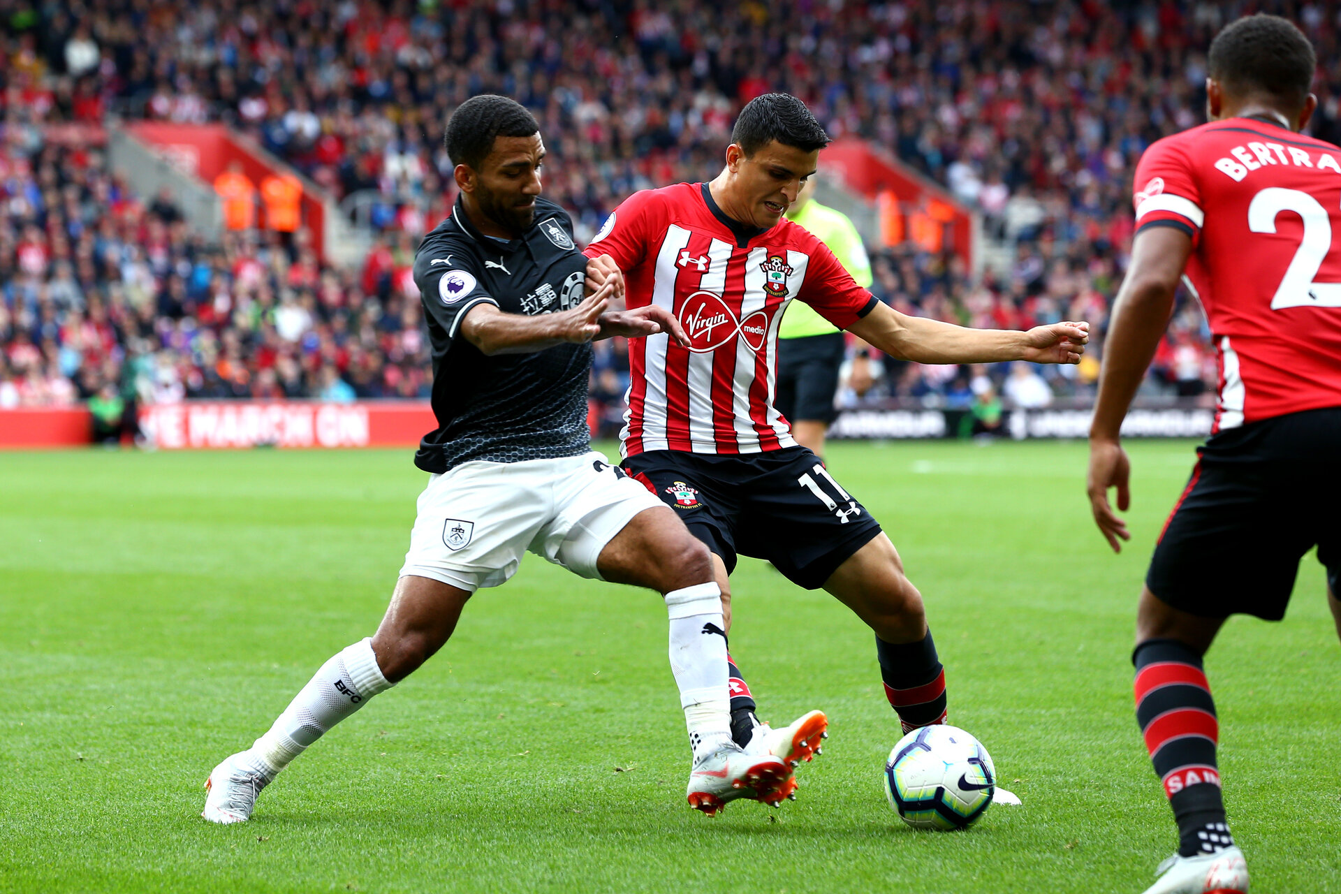 SOUTHAMPTON, ENGLAND - AUGUST 12: Mohamed Elyounoussi (middle) of Southampton FC  during the Premier League match between Southampton FC and Burnley FC at St Mary's Stadium on August 12, 2018 in Southampton, United Kingdom. (Photo by James Bridle - Southampton FC/Southampton FC via Getty Images)