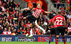 SOUTHAMPTON, ENGLAND - AUGUST 12: Jannik Vestergaard (middle) of Southampton FC  goes to head the ball during the Premier League match between Southampton FC and Burnley FC at St Mary's Stadium on August 12, 2018 in Southampton, United Kingdom. (Photo by James Bridle - Southampton FC/Southampton FC via Getty Images)