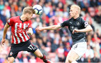 SOUTHAMPTON, ENGLAND - AUGUST 12: Stuart Armstrong(L) of Southampton and Ben Mee(R) of Burnley during the Premier League match between Southampton FC and Burnley FC at St Mary's Stadium on August 12, 2018 in Southampton, United Kingdom. (Photo by Matt Watson/Southampton FC via Getty Images)