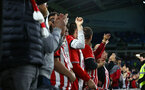BRIGHTON, ENGLAND - AUGUST 28: Southampton FC  fans cheer during the Carabao Cup Second Round match between Brighton & Hove Albion and Southampton at American Express Community Stadium on August 28, 2018 in Brighton, England. (Photo by James Bridle - Southampton FC/Southampton FC via Getty Images)