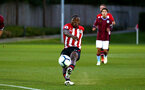 SOUTHAMPTON, ENGLAND - SEPTEMBER 21: Michael Obafemi falls backwards as he kicks the ball (middle) during the PL2 match between Southampton FC and Aston Villa FC at Staplewood Training Ground on September 21, 2018 in Southampton, United Kingdom. (Photo by James Bridle - Southampton FC/Southampton FC via Getty Images)