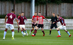 SOUTHAMPTON, ENGLAND - SEPTEMBER 21: Will Smallbone, Callum Slattery during the PL2 match between Southampton FC and Aston Villa FC at Staplewood Training Ground on September 21, 2018 in Southampton, United Kingdom. (Photo by James Bridle - Southampton FC/Southampton FC via Getty Images)