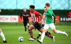 SOUTHAMPTON, ENGLAND - SEPTEMBER 22: Christian Norton (left) during the U18 Premier League match between Southampton FC and Brighton Hove Albion at Staplewood Training Ground on September 22, 2018 in Southampton, United Kingdom. (Photo by James Bridle - Southampton FC/Southampton FC via Getty Images)