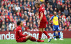 LIVERPOOL, ENGLAND - SEPTEMBER 22: Virgil Van Dijk of Liverpool goes down with an injury during the Premier League match between Liverpool FC and Southampton FC at Anfield on September 22, 2018 in Liverpool, United Kingdom. (Photo by Matt Watson/Southampton FC via Getty Images)