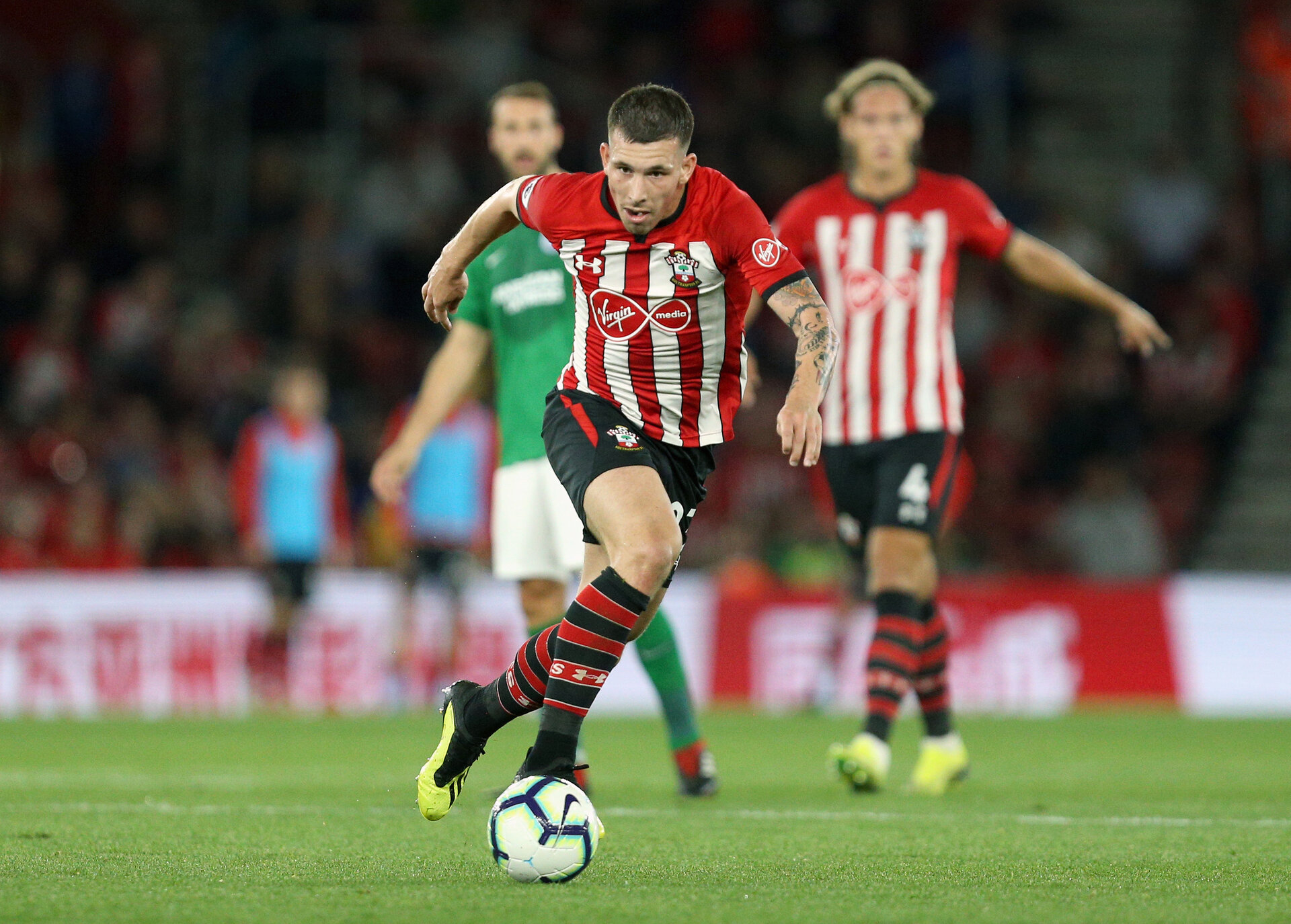 SOUTHAMPTON, ENGLAND - SEPTEMBER 17: Pierre-Emile Hojbjerg of Southampton runs with the ball during the Premier League match between Southampton FC and Brighton & Hove Albion at St Mary's Stadium on September 17, 2018 in Southampton, United Kingdom.  (Photo by Southampton FC/Southampton FC via Getty Images) *** Local Caption *** Pierre-Emile Hojbjerg SOUTHAMPTON, ENGLAND - SEPTEMBER 17: Pierre-Emile Hojbjerg of Southampton runs with the ball during the Premier League match between Southampton FC and Brighton & Hove Albion at St Mary's Stadium on September 17, 2018 in Southampton, United Kingdom.  (Photo by Southampton FC/Southampton FC via Getty Images)