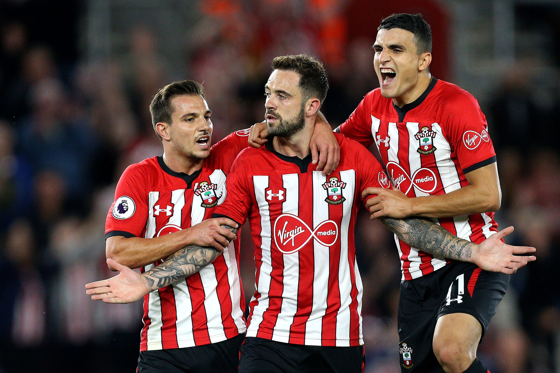 SOUTHAMPTON, ENGLAND - SEPTEMBER 17: Danny Ings of Southampton celebrates after scoring his team's second goal with Cedric Soares of Southampton and Mohamed Elyounoussi of Southampton during the Premier League match between Southampton FC and Brighton & Hove Albion at St Mary's Stadium on September 17, 2018 in Southampton, United Kingdom.  (Photo by Southampton FC/Southampton FC via Getty Images) *** Local Caption *** Danny Ings;Cedric Soares;Mohamed Elyounoussi SOUTHAMPTON, ENGLAND - SEPTEMBER 17: Danny Ings of Southampton celebrates after scoring his team's second goal with Cedric Soares of Southampton and Mohamed Elyounoussi of Southampton during the Premier League match between Southampton FC and Brighton & Hove Albion at St Mary's Stadium on September 17, 2018 in Southampton, United Kingdom.  (Photo by Southampton FC/Southampton FC via Getty Images)