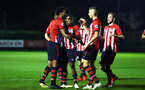 SOUTHAMPTON, ENGLAND - SEPTEMBER 26: Marcus Barnes (left) scores for Southampton FC and celebrates with team during the International Cup where Southampton FC play FC Porto pictured at Southampton training session at Staplewood Complex on September 26, 2018 in Southampton, England. (Photo by James Bridle - Southampton FC/Southampton FC via Getty Images)